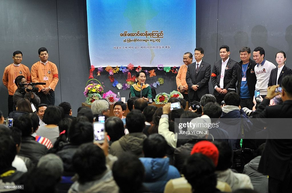 Myanmar's opposition leader Aung San Suu Kyi (C) speaks during a meeting with Myanmar people living in South Korea, in Seoul on February 1, 2013. Suu Kyi arrived in South Korea on January 28 for a four-day visit including meetings with politicians and a soap-opera star and the collection of a human rights award.