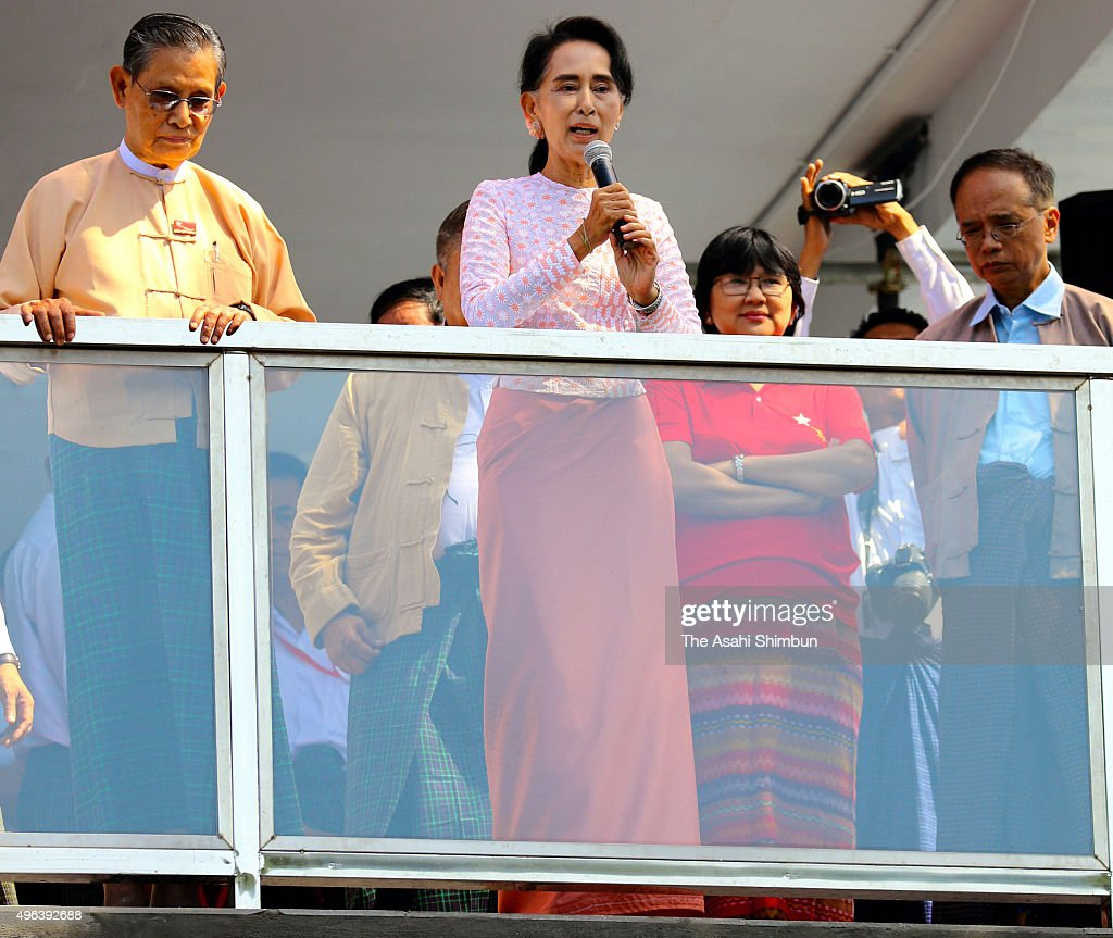 Myanmar's opposition National League for Democracy (NLD) leader <a gi-track='captionPersonalityLinkClicked' href=/galleries/search?phrase=Aung+San+Suu+Kyi&family=editorial&specificpeople=214208 ng-click='$event.stopPropagation()'>Aung San Suu Kyi</a> addresses from a balcony of the NLD headquarters a day after the general election on November 9, 2015 in Yangon, Myanmar.