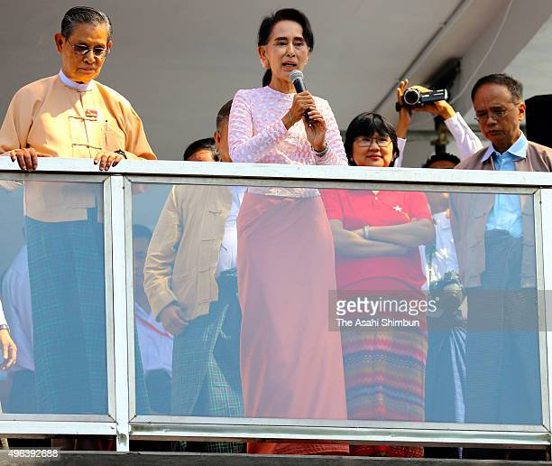 Myanmar's opposition National League for Democracy leader Aung San Suu Kyi addresses from a balcony of the NLD headquarters a day after the general...