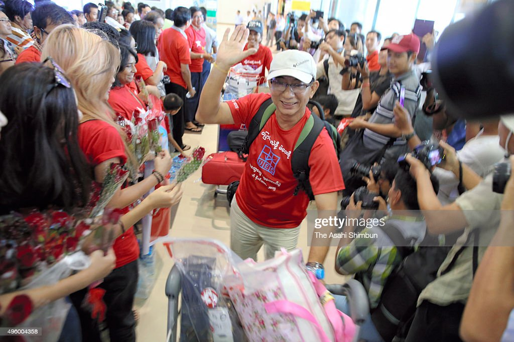 A Myanmar's opposition National League for Democracy supporter who currently live in Singapore is welcomed on arrival by NLD supporters as he returns...