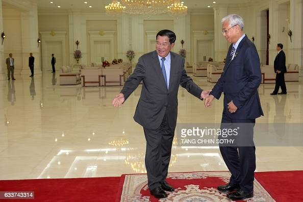 Myanmar's President Htin Kyaw is welcomed by Cambodian Prime Minister Hun Sen upon his arrival at the Peace Palace in Phnom Penh on February 4 2017...