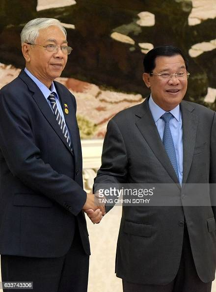 Myanmar's President Htin Kyaw shakes hands with Cambodian Prime Minister Hun Sen upon his arrival at the Peace Palace in Phnom Penh on February 4...