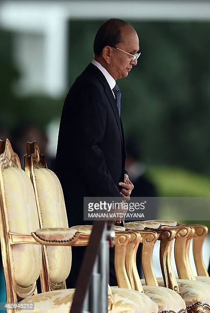 Myanmar's President Thein Sein arrives to inspect a ceremonial guard of honour during a welcome ceremony at the Parliament in Kuala Lumpur on March...