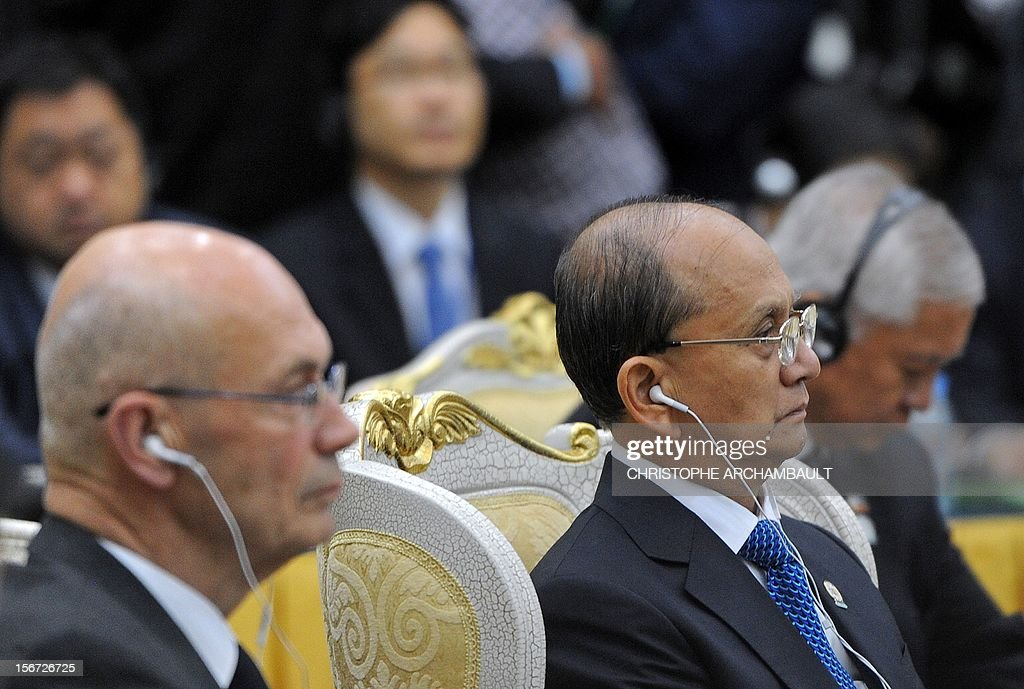 Myanmar's President Thein Sein (C) attends the Association of Southeast Asian Nations (ASEAN) Global Dialogue meeting as part of the ASEAN and related summits in Phnom-Penh on November 20, 2012. Asian leaders feuded over how to handle tense maritime territorial disputes with China, overshadowing talks at a regional summit meant to strengthen trade and political ties. AFP PHOTO/Christophe ARCHAMBAULT