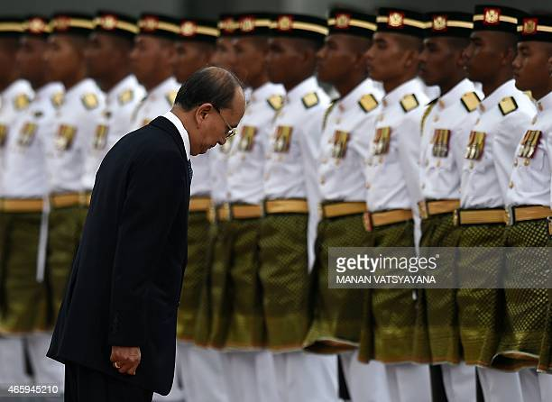 Myanmar's President Thein Sein inspects a ceremonial guard of honour during a welcome ceremony at the Parliament in Kuala Lumpur on March 12 2015...
