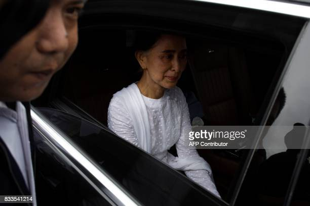 TOPSHOT Myanmar's State Counselor Aung San Suu Kyi leaves after attending the funeral service for the National League for Democracy party's former...