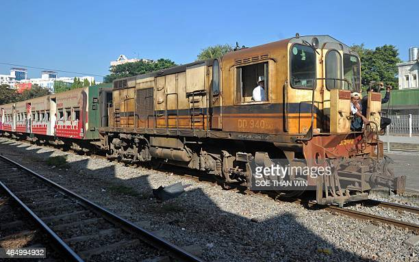 MyanmartransportrailheritageeconomyFEATURE by Kelly Macnamara This picture taken on November 26 2014 shows a locomotive approaching a train station...