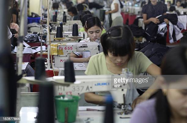 STORY 'MyanmarUSsanctionstradeFOCUS' by Shwe Yinn Mar Oo This picture taken on September 27 2012 shows Myanmar labourers working at a garment factory...