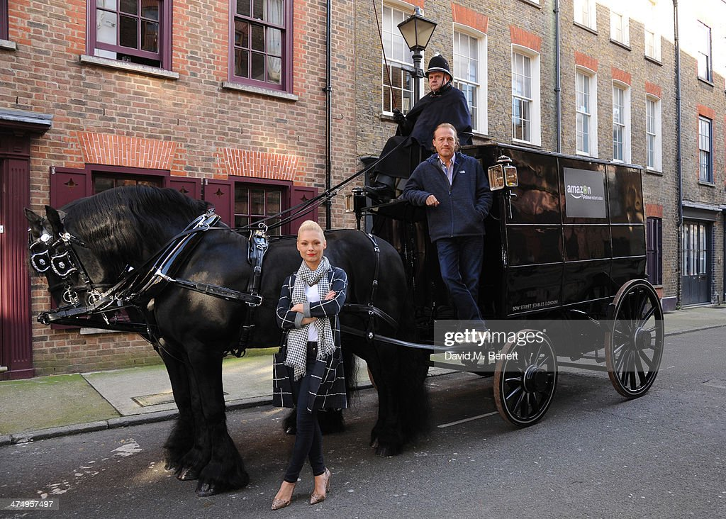 MyAnna Buring and Jerome Flynn pose with horse and carriage for the launch of drama 'Ripper Street' on Amazon Prime Instant Video, on February 26, 2014 in London, England.