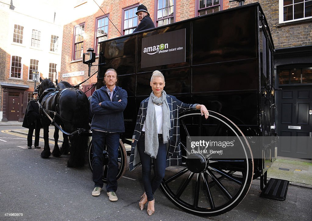 <a gi-track='captionPersonalityLinkClicked' href=/galleries/search?phrase=MyAnna+Buring&family=editorial&specificpeople=810502 ng-click='$event.stopPropagation()'>MyAnna Buring</a> and Jerome Flynn pose with horse and carriage for the launch of drama 'Ripper Street' on Amazon Prime Instant Video, on February 26, 2014 in London, England.