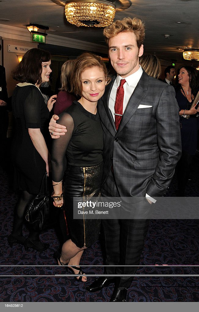 MyAnna Buring (L) and Sam Claflin arrive at the Jameson Empire Awards 2013 at The Grosvenor House Hotel on March 24, 2013 in London, England.