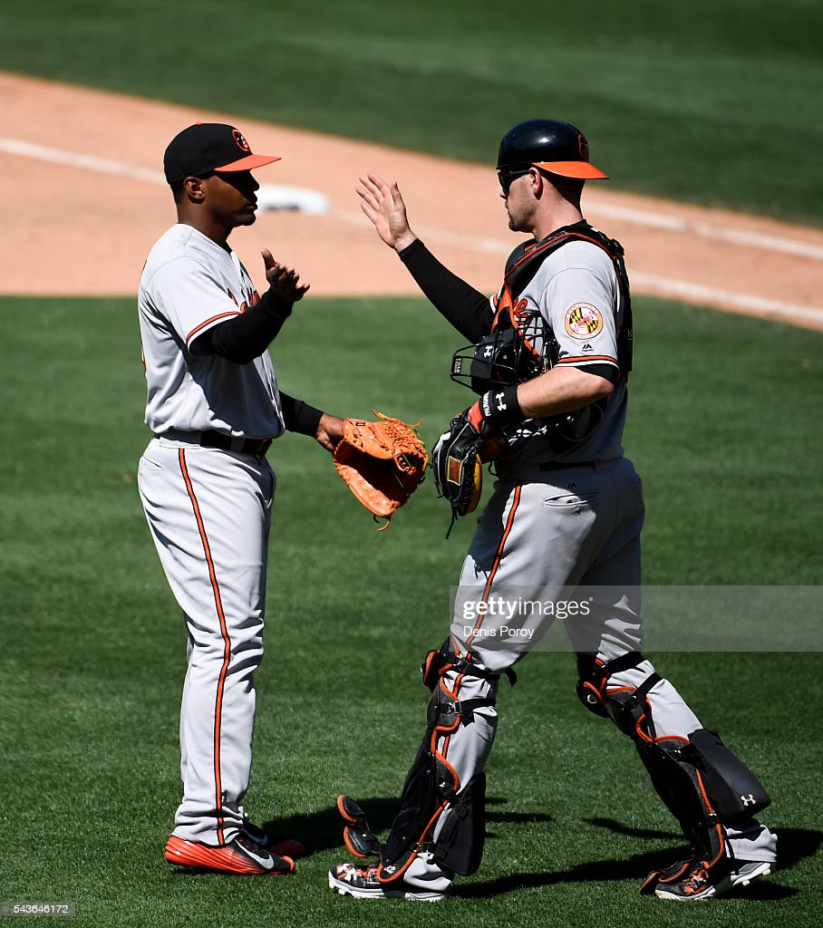Mychal Givens #60 of the Baltimore Orioles, left, is congratulated by <a gi-track='captionPersonalityLinkClicked' href=/galleries/search?phrase=Matt+Wieters&family=editorial&specificpeople=4498276 ng-click='$event.stopPropagation()'>Matt Wieters</a> #32 after beating the San Diego Padres 12-6 in a baseball game at PETCO Park on June 29, 2016 in San Diego, California.