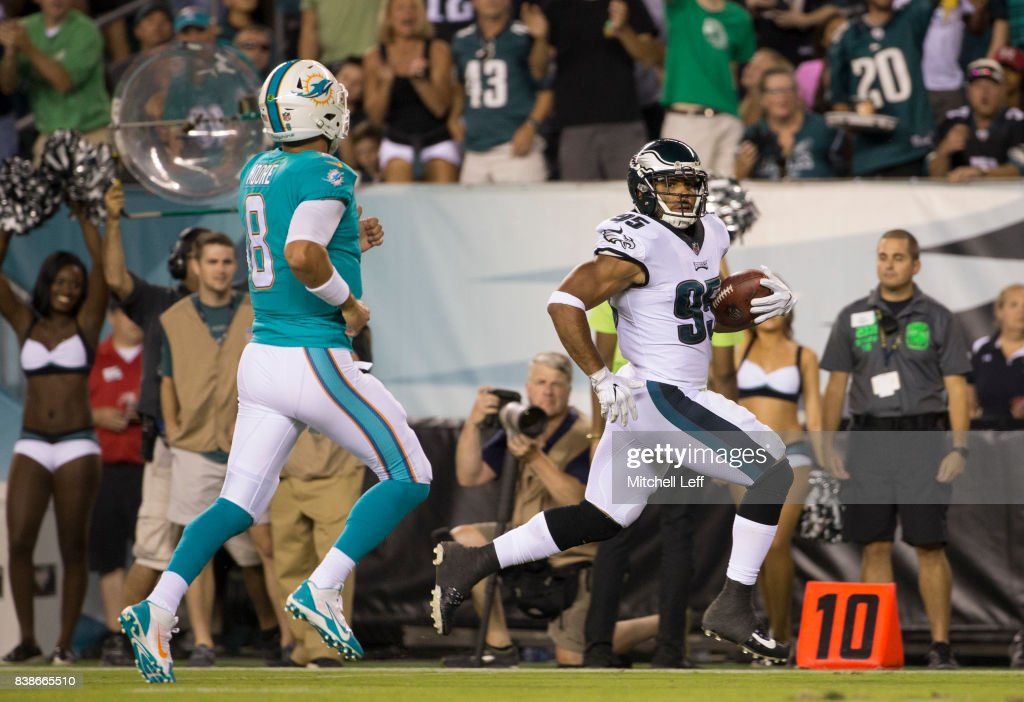 Mychal Kendricks #95 of the Philadelphia Eagles intercepts the ball and runs past Matt Moore #8 of the Miami Dolphins to score a touchdown in the second quarter in the preseason game at Lincoln Financial Field on August 24, 2017 in Philadelphia, Pennsylvania. The Eagles defeated the Dolphins 38-31.