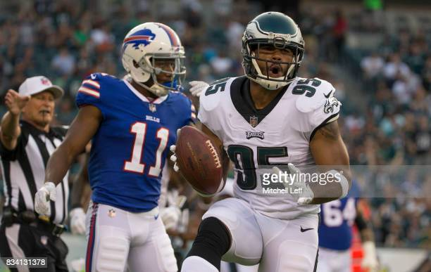 Mychal Kendricks of the Philadelphia Eagles reacts in front of Zay Jones of the Buffalo Bills after his interception in the first quarter of the...