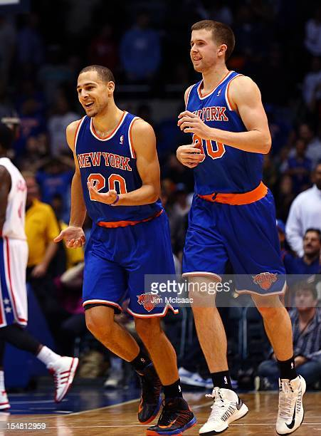Mychel Thompson and John Shurna of the New York Knicks in action against the Brooklyn Nets during a preseason game at Nassau Coliseum on October 24...