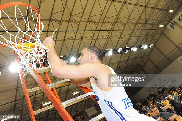 Mychel Thompson of the Santa Cruz Warriors cuts down the net after winning the NBA DLeague Championship defeating the Fort Wayne Mad Ants in Game Two...