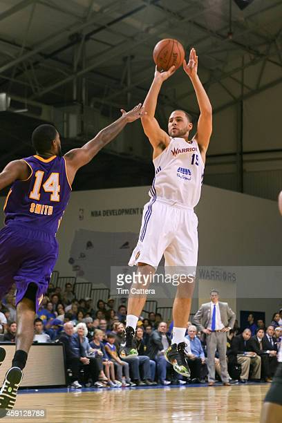 Mychel Thompson of the Santa Cruz Warriors shoots a jump shot against Roscoe Smith of the Los Angeles Defenders on Nov 14 2014 at Kaiser Permanente...