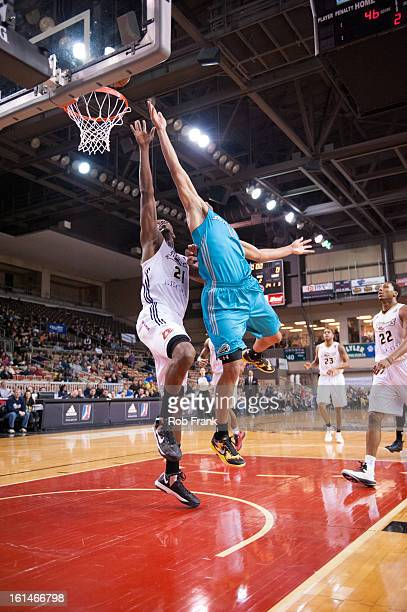 Mychel Thompson shoots a layup against Henry Sims during a NBA DLeague game between the Sioux Falls Skyforce and the Erie Bayhawks on February 8 2013...