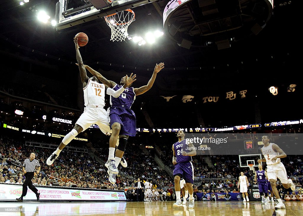 Myck Kabongo #12 of the Texas Longhorns is fouled by Charles Hill Jr. #0 of the TCU Horned Frogs on a fast break during the first round of the 2013 Big 12 Men's Basketball Championship at Sprint Center on March 13, 2013 in Kansas City, Missouri.
