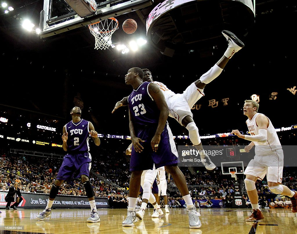 Myck Kabongo #12 of the Texas Longhorns is fouled by Devonta Abron #23 of the TCU Horned Frogs during the first round of the 2013 Big 12 Men's Basketball Championship at Sprint Center on March 13, 2013 in Kansas City, Missouri.