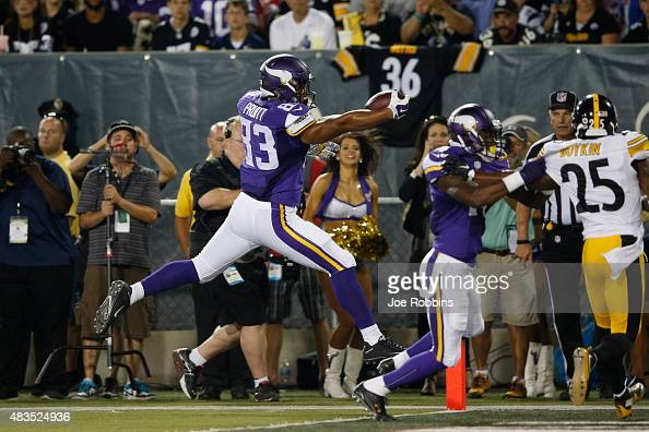 MyCole Pruitt of the Minnesota Vikings jumps across the goal line for a 34yard touchdown reception in the second quarter of the NFL Hall of Fame Game...