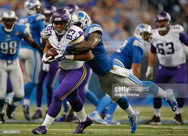 MyCole Pruitt of the Minnesota Vikings tries to escape the tackle of Tahir Whitehead of the Detroit Lions after a third quarter catch at Ford Field...