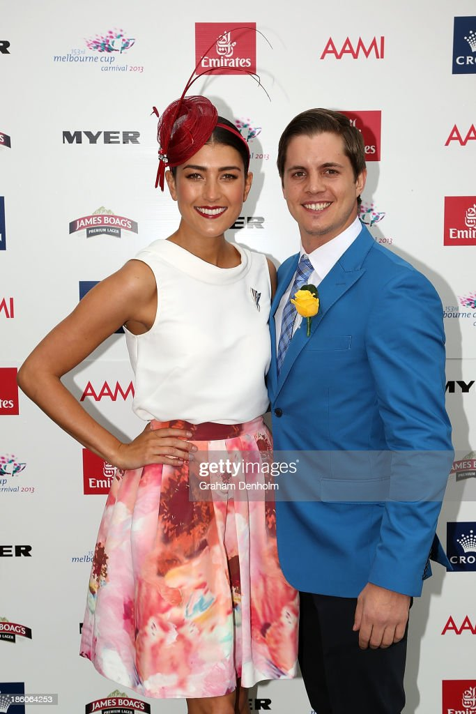 Myer Fashions on the Field Ambassador Rebecca Bramich (L) poses with 2013 Emirates Stakes Day Fashion on the Field Ambassador Johnny Ruffo at the 2013 Melbourne Cup Carnival Launch at Flemington Racecourse on October 28, 2013 in Melbourne, Australia.