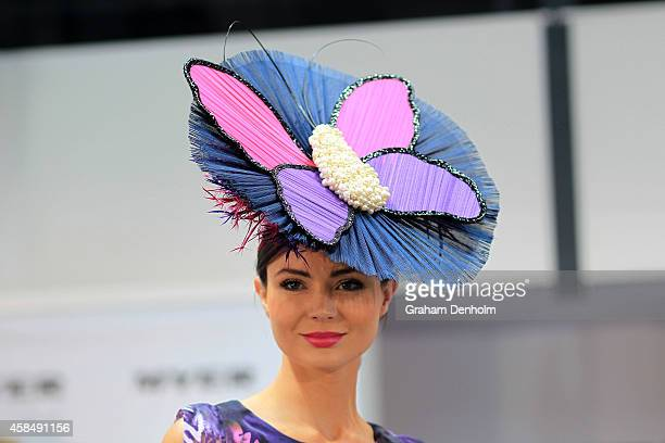 Myer Fashions on the Field Millinery Award entrants walk the catwalk in the Fashion on the Field enclosure on Oaks Day at Flemington Racecourse on...