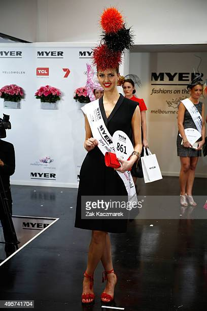 Myer Fashions on the Field Millinery Awards winner Alice Anderson poses on Crown Oaks Day at Flemington Racecourse on November 5 2015 in Melbourne...