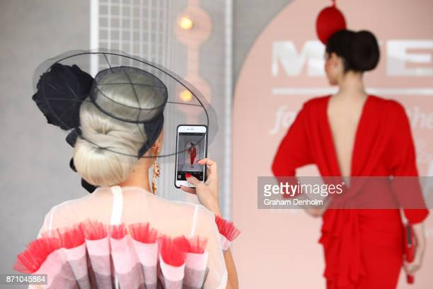 Myer Fashions on the Field participant poses on Emirates Melbourne Cup Day at Flemington Racecourse on November 7 2017 in Melbourne Australia