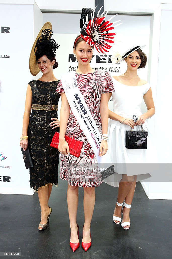 Myer Fashions on the Field Victorian women's racewear winner, Chloe Moo (C), poses with runners up Ashleigh Albanese, and Ashleigh Barri during Crown Oaks Day at Flemington Racecourse on November 7, 2013 in Melbourne, Australia.
