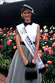 Myer Fashions on the Field Women's Racewear winner Courtney Moore poses in the Fashion on the Field enclosure on Victoria Derby Day at Flemington...