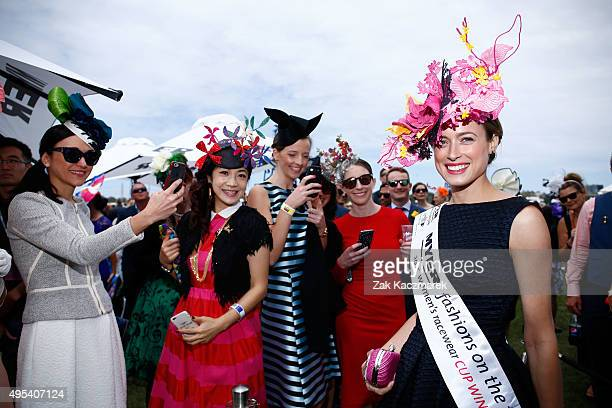 Myer Fashions on the Field Women's Racewear winner Emily Hunter poses on Melbourne Cup Day at Flemington Racecourse on November 3 2015 in Melbourne...