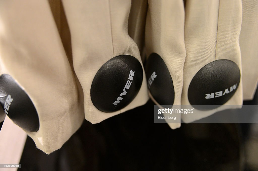 Myer Holdings Ltd. branded security tags hang from the legs of trousers displayed at the company's Melbourne City store in Melbourne, Australia, on Wednesday, March 13, 2013. Myer is scheduled to release company results on March 14. Photographer: Carla Gottgens/Bloomberg via Getty Images