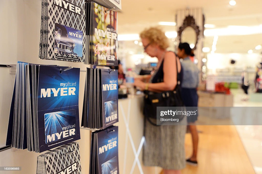 Myer Holdings Ltd. gift vouchers hang on a wall near a cashier at the company's Melbourne City store in Melbourne, Australia, on Wednesday, March 13, 2013. Myer is scheduled to release company results on March 14. Photographer: Carla Gottgens/Bloomberg via Getty Images
