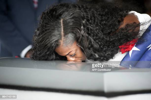 Myeshia Johnson kisses the casket of her husband Army Sgt La David Johnson during his burial service for at the Memorial Gardens East cemetery on...