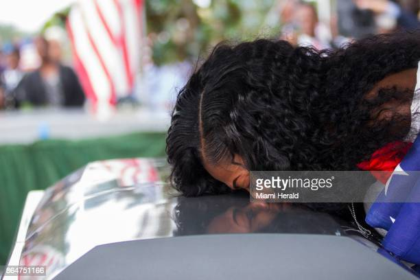 Myeshia Johnson kisses the casket of her husband Sgt La David Johnson during his burial service at Fred Hunter's Hollywood Memorial Gardens in...