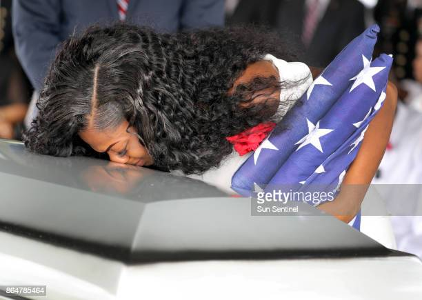 Myeshia Johnson the wife of Army Sgt La David Johnson kisses her husband's casket during his burial at Fred Hunter's Hollywood Memorial Gardens in...