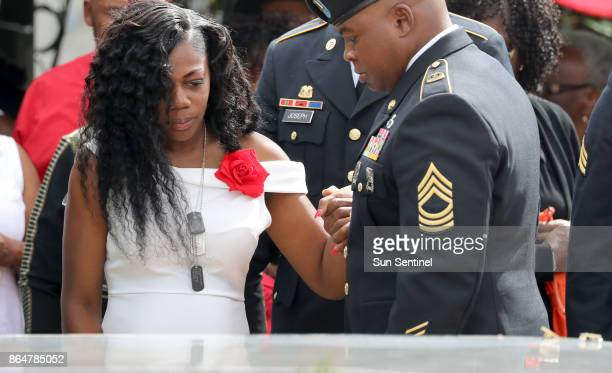 Myeshia Johnson the wife of Army Sgt La David Johnson looks down at his casket during his burial at Fred Hunter's Hollywood Memorial Gardens in...