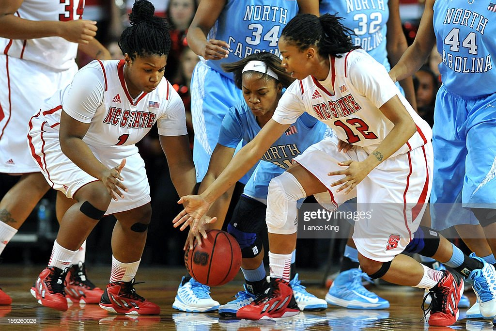 Myisha Goodwin-Coleman #1 and Krystal Barrett #12 of the North Carolina State Wolfpack fight for a loose ball against Brittany Rountree #11 of the North Carolina Tar Heels at Reynolds Coliseum on January 10, 2013 in Raleigh, North Carolina.