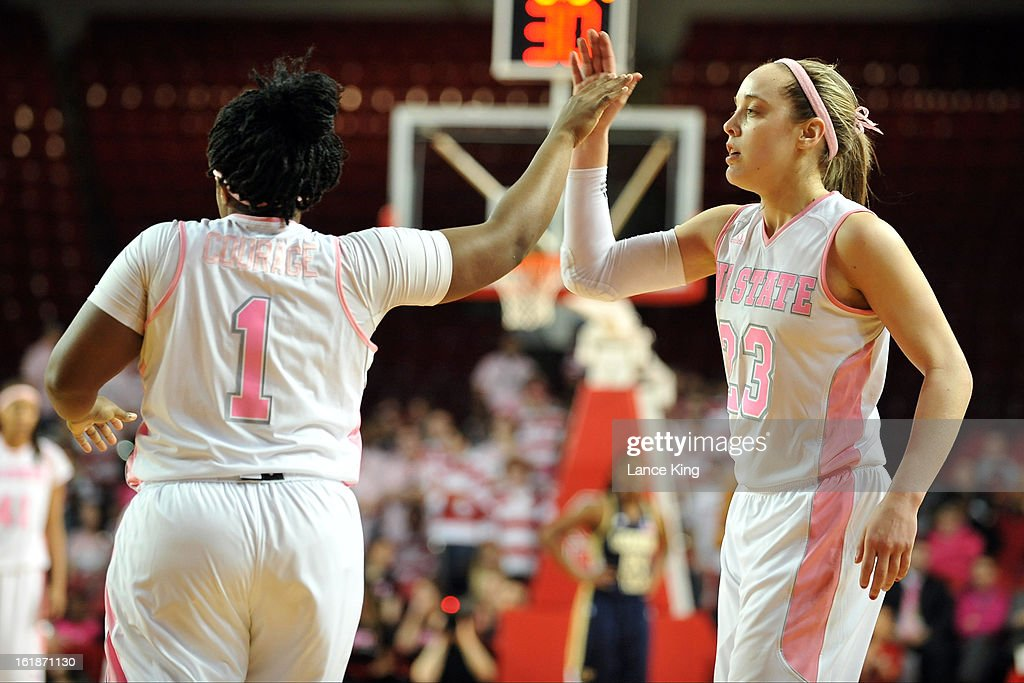 Myisha Goodwin-Coleman #1 high-fives Marissa Kastanek #23 of the North Carolina State Wolfpack during a game against the Georgia Tech Yellow Jackets at Reynolds Coliseum on February 17, 2013 in Raleigh, North Carolina.