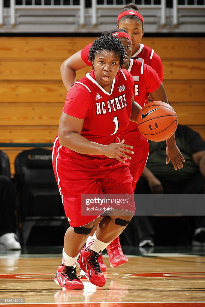 Myisha Goodwin-Coleman #1 of the North Carolina State Wolfpack brings the ball up court against the Miami Hurricanes on December 20, 2012 at the BankUnited Center in Coral Gables, Florida. The Hurricanes defeated the Wolfpack 79-53.