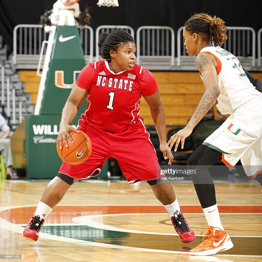 Myisha Goodwin-Coleman #1 of the North Carolina State Wolfpack dribbles the ball against Suriya McGuire #33 of the Miami Hurricanes on December 20, 2012 at the BankUnited Center in Coral Gables, Florida. The Hurricanes defeated the Wolfpack 79-53.