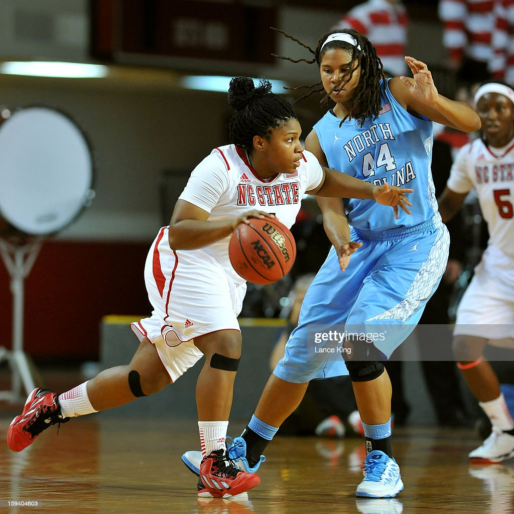 Myisha Goodwin-Coleman #1 of the North Carolina State Wolfpack dribbles against Tierra Ruffin-Pratt #44 of the North Carolina Tar Heels at Reynolds Coliseum on January 10, 2013 in Raleigh, North Carolina.