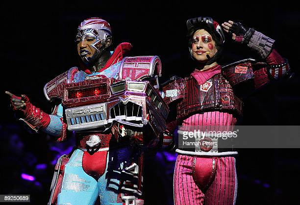 Mykal Rand who plays the character 'Electra' appears on stage with Duane McGregor who plays the character 'Caboose' in 'Starlight Express' during the...