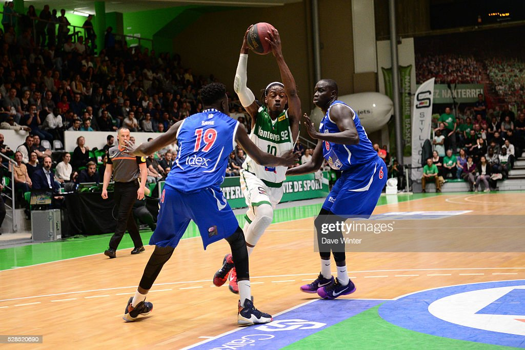 Mykal Riley of Nanterre (centre) slips between Landing Sane of Paris Levallois (left) and Maleye Ndoye of Paris Levallois (right) during the basketball French Pro A League match between Nanterre and Paris Levallois on May 5, 2016 in Nanterre, France.