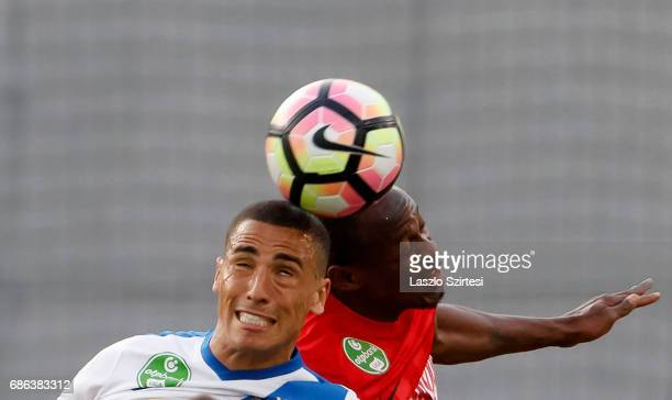 Myke Bouard Ramos of MTK Budapest competes for the ball in the air with Patrick Mevoungou of DVTK during the Hungarian OTP Bank Liga match between...