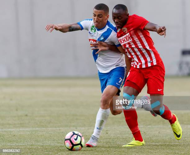 Myke Bouard Ramos of MTK Budapest fights for the ball with Patrick Mevoungou of DVTK during the Hungarian OTP Bank Liga match between MTK Budapest...