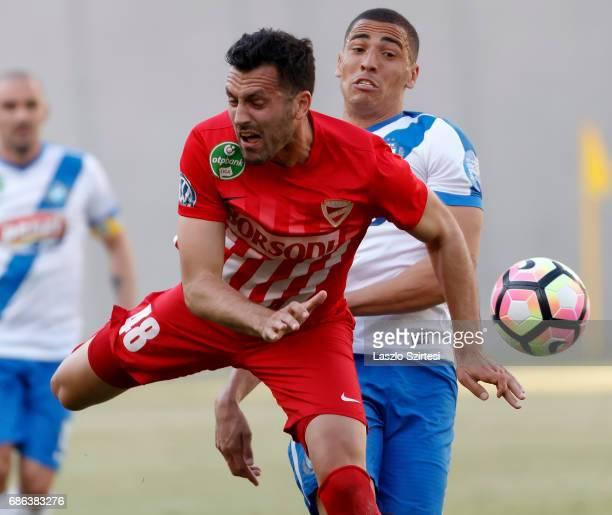 Myke Bouard Ramos of MTK Budapest fouls Dejan Karan of DVTK during the Hungarian OTP Bank Liga match between MTK Budapest and DVTK at Nandor...