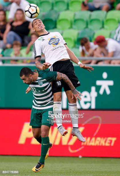 Myke Bouard Ramos of Swietelsky Haladas wins the ball in the air from Marcos Pedroso of Ferencvarosi TC during the Hungarian OTP Bank Liga match...